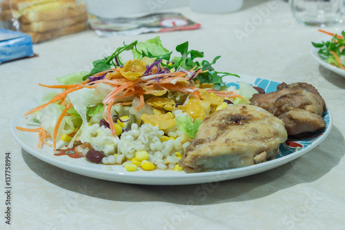 "Delicious salad with chicken, nuts, egg and vegetables."" zdjęć ..."