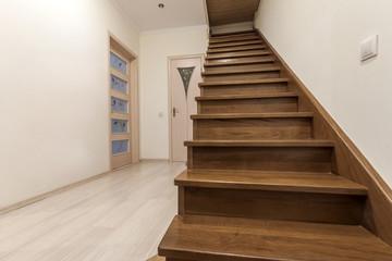 Foto op Plexiglas Trappen Modern architecture interior with elegant luxury hallway with glossy wooden staps stairs in modern storey house