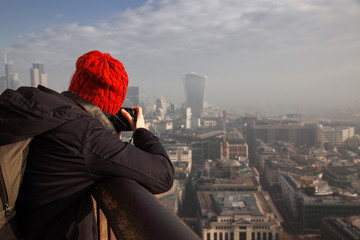 woman tourist on top of St Paul's cathedral, London