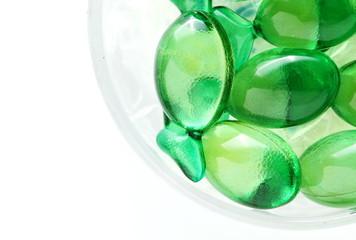 The green color vitamin capsule represent the medicine and healthcare concept related idea.