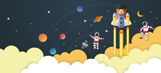 Astronaut cartoon with a spaceship in space,paper cut