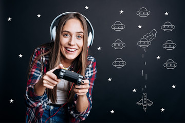 Cheerful delighted woman playing video games