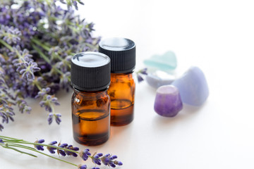 essential oils with lavender in white background
