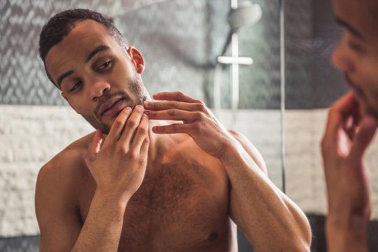 Afro American man in bathroom