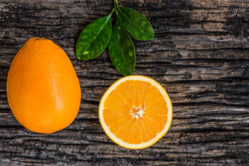 oranges fruits on wooden background