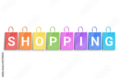 Shopping word written on colorful shopping bags. Free space for ...
