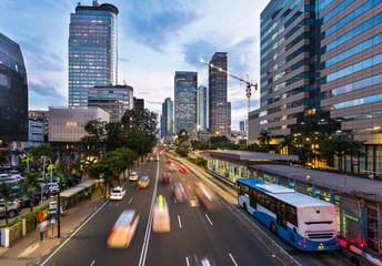 Traffic rushing in Jakarta business district in Indonesia capital city Wall mural