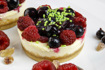 mini cheesecakes with mixed berries