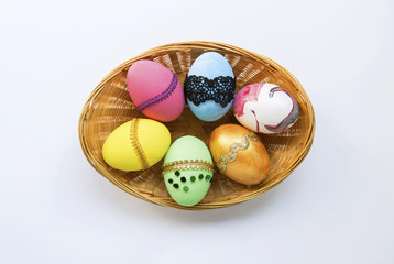 Beautiful design Easter egg collections in bamboo basket on white background
