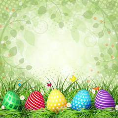 Golden Easter eggs on the grass