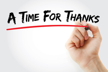 Hand writing A Time For Thanks with marker, concept background