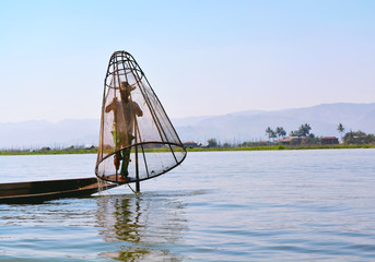 Fisherman catching fish on the boat in Inle lake, Myanmar