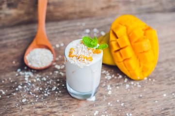 Homemade yogurt with fresh mango slices