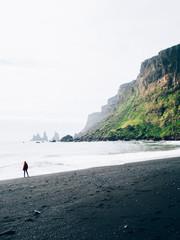 A person on a rocky coast