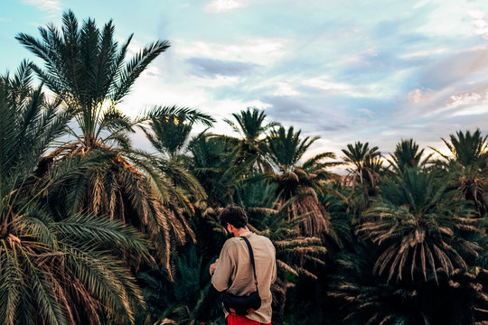 Man in dried palms
