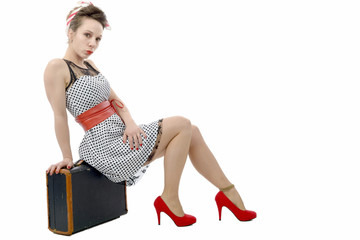 beautiful woman in retro style with suitcase