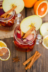 Mulled wine in glass mug   with spices and citrus fruit