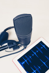 microphone, headphone & computer tablet for recording or podcast concept