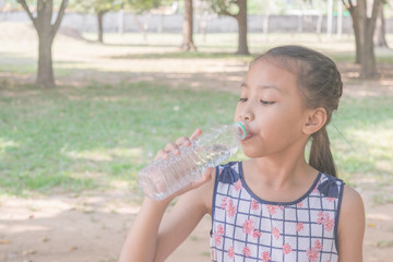 Asian girl drinking water.
