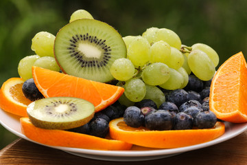 Mixed fruits in a plate with natural background