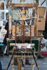 Creative view of painter's easel on Place du Tertre in Montmartre, Paris, France.