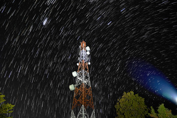 Star trails over antenna tower.