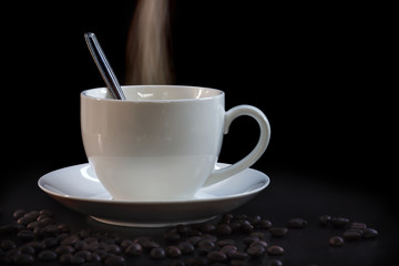 Hot cup of coffee in white on a dark background.