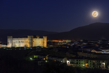 Night view of the castle of El Barco de Avila, Spain.