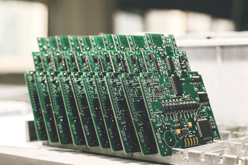 Computer board with chips at the factory for the production of computer components.