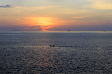 Thai ferryboat on the way back home during sunset