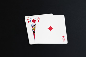 Playing poker cards ace king on black background
