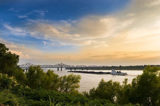 A pusher boat in the Mississippi River near the Vicksburg Bridge in Vicksburg, Mississippi, USA.