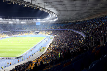 Panoramic view of modern stadium during football match