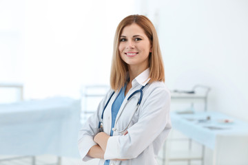 Beautiful doctor with stethoscope in modern clinic