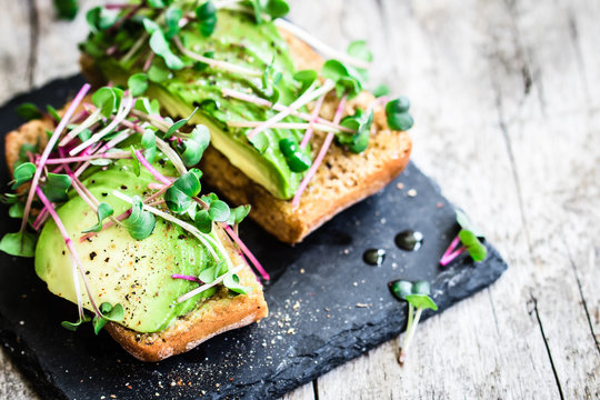 Delicious vegan sandwich with avocado and radish cress