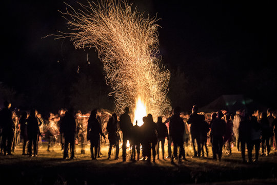 People Dancing around a Bonfire