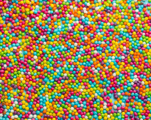 Colorful sugar sprinkles dots as a background , rainbow