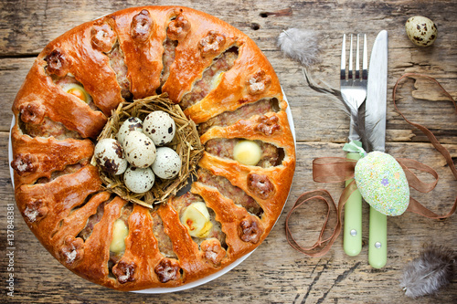 Photo: Easter bread ring stuffed with minced meat and quail eggs on ...