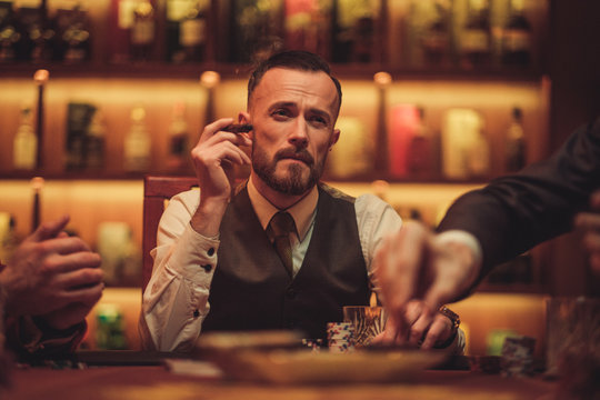 Man playing poker in gentlemen's club