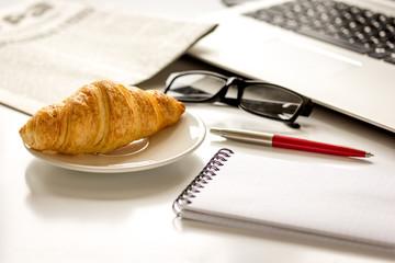 Office breakfast with laptop on white desk