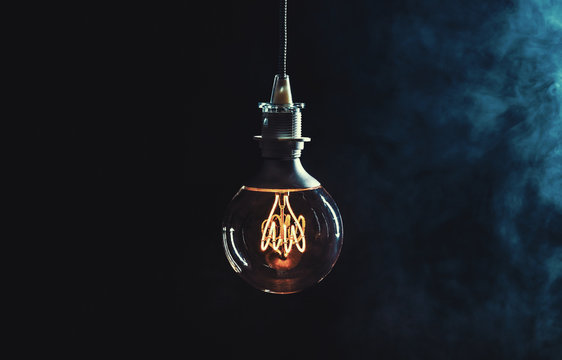 Vintage lightbulb on dark background