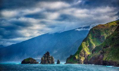 Black rocks in the ocean and coastline of Madeira island