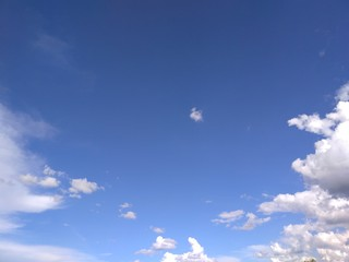 Degrade blue sky with clouds