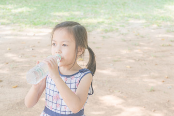 Asian girl drinking water.