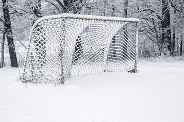 Old football gate in a village in winter.