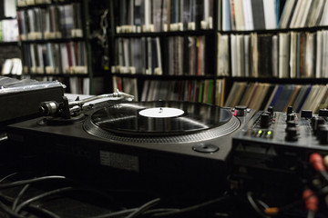 DJ Turntable Playing Vinyl at Record Store