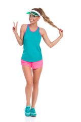 Happy Woman In Sport Clothes Showing Peace Sign