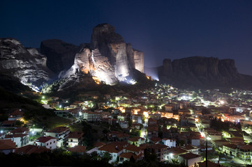 Kalampaka town at night with floodlit cliffs, Meteora, Greece, October 2008