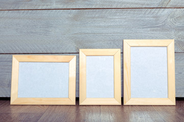 photo frames on the wooden wall
