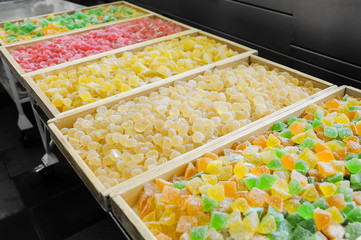 Sweet fresh colorful fruit candy at the confectionery factory ready for sale